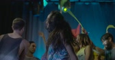 abroncs : Woman dancing with friends and having fun in nightclub Stock mozgókép