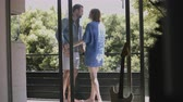 heterossexual : Young couple kissing and enjoying while standing in balcony Vídeos