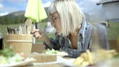 stylish : Woman eating a meal outdoors