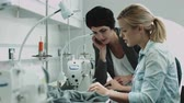 collaborating : Fashion designers at sewing machine working together Stock Footage