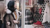 pencere : Female friends shopping and looking at shop window Stok Video