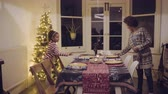 multietnikus : Mother and daughter prepare Christmas dinner table
