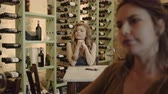 Young adult checking smart phone at wine bar Stock Footage