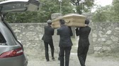 Pallbearers in Hearse arriving with coffin at graveyard Стоковые видеозаписи
