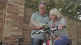 Senior couple planning bike tour Стоковые видеозаписи