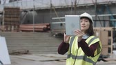 mérnök : Construction supervisor taking picture with digital tablet of project development Stock mozgókép
