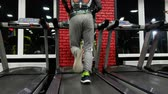inşaat : In the Gym: Treadmill, close up video. Young man jogging Stok Video