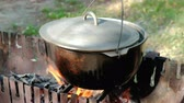 zupa rybna : Cooking soup. Food In A Cauldron On A Fire.