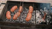 koperek : Grilling Sausages On Barbecue Grill. Pork Sausages Grilling On A Portable Bbq