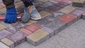 Man Is Doing Sidewalk Tiles