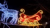 Christmas Deer with sledge. New Year, Night Decor Atmosphere