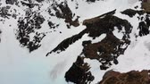 холодный : Aerial overhead plane of a snowy mountain pass