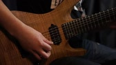 chitarra : Rock musician plays solo guitar. Close up of rock guitar solo. Closeup of rock guitar player hands. Rock guitarist. Young man playing electric guitar Filmati Stock
