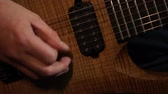 enstrüman : Rock musician plays solo guitar. Close up of rock guitar solo. Closeup of rock guitar player hands. Rock guitarist. Young man playing electric guitar Stok Video