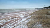 Winter coastal landscape with snow on the beach and waves. Gulf of Finland, Baltic sea, Russia Stock mozgókép