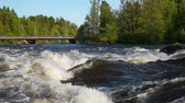 Landscape of Kymi river in Finland, fast water motion and cars go over the bridge Stock mozgókép
