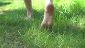womens legs are on the grass