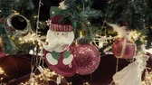 Greeting Season concept. Gimbal shot of ornaments on Christmas tree with decorative light and front home with door in 4k (UHD) Stock Footage