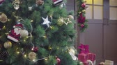 flow : Greeting Season concept. Gimbal shot of ornaments on Christmas tree with decorative light and front home with door in 4k (UHD) Stock Footage