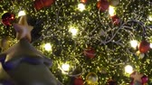 papai noel : Greeting Season concept.Gimbal shot of ornaments on a Big Christmas tree with decorative light in 4k (UHD)