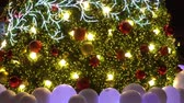 Greeting Season concept.Gimbal shot of ornaments on a Big Christmas tree with decorative light in 4k (UHD)