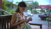 Woman gets message and takes phone to read it smiling close up 4k. Stock Footage
