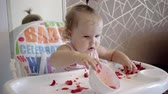 fragola : Cute little baby girl portrait funny eating red strawberries all smeared