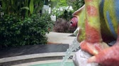 beautiful building : splashes of water from the fountain in the form of a bright multi-colored lizard. 4k Stock Footage