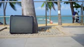 csalódott : TV stands on the beach. Television stand on the beach of the sea.