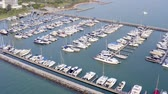 yachting : Aerial View by Drone of Yacht Club and Marina. Top view of yacht club. White boats in sea water. Marina dock yachts and small moto. Yacht and sailboat.