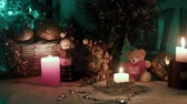 decorativo : Candles balls and bears on the table Christmas atmosphere Stock Footage