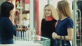 smell : Girls chooses perfume in small shop