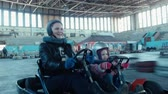 gokart : Mother and little daughter rides on karting