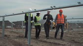 architektura : The men and women talking about the plan on unfinished solar farm