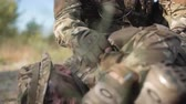 salvação : The soldier saves getting injured while shooting and having contact on battlefield. Stock Footage
