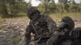 recon : Slow motion the soldier saves getting injured while shooting and having contact on battlefield.