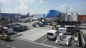 carrier : Paris, France - October 18, 2018: View of modern blue jumbo jet being loaded with luggage and cargo before flight in airport