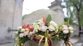 marry : Beautiful wedding bouquet and rings on concrete