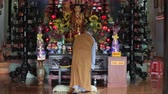 a view of a buddhist monk with orange robe pray in temple 30 July, Nha Trang, Vietnam