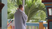 cultura thai : a view of a buddhist monk with orange robe pray in temple 30 July, Nha Trang, Vietnam