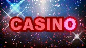 CASINO text animation with fireworks, glitter, confetti and lots of energy! Seamless looping animation.- Стоковые видеозаписи