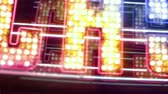 Looking up POV of a generic Las Vegas neon casino sign. Selective focus on center, multi-color effects added in post.
