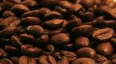 напиток : 15 second seamless loop of roasted certified organic coffee beans. Shot on 3CCD HD 1080p.-