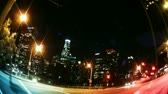 nagylátószögű : Los Angeles Skyline at night with traffic streaking by, city buildings and lights.-