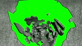 breaking : Keyable chroma green transition  reveal of person smashing through concrete wall animation. Reveals to key-able chroma 255 green.