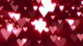 romance : Icon hearts floating upward, light rays and glows. HD 1080 Seamless Loop.-