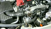 звук : View under the hood as car engine starts. Shot on HD 1080.-