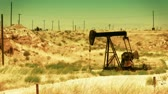 pompki : Oil pump at an oil field in the California desert. Shot on HD 1080. Wideo