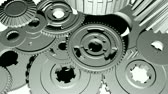 шестерня : 3D animation of gears turning with teeth interlocking. Seamless looping video animation.-