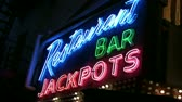 organismo : Shot of a generic restaurant, bar & jackpots neon sign at night.